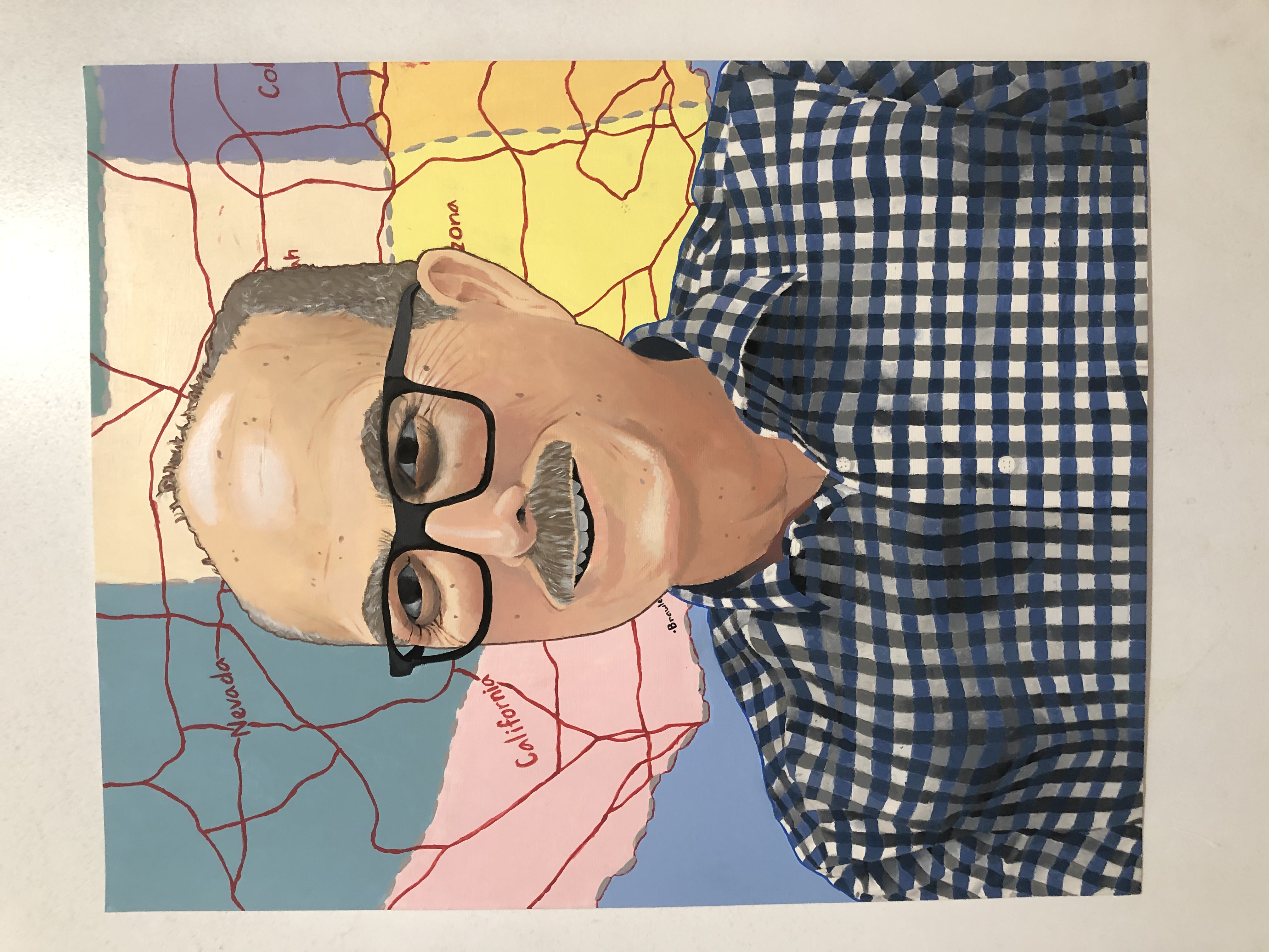 A painting of a U.S. History teacher, wearing glasses and a blue plaid shirt. In the background is part of a colorful map of the United States.